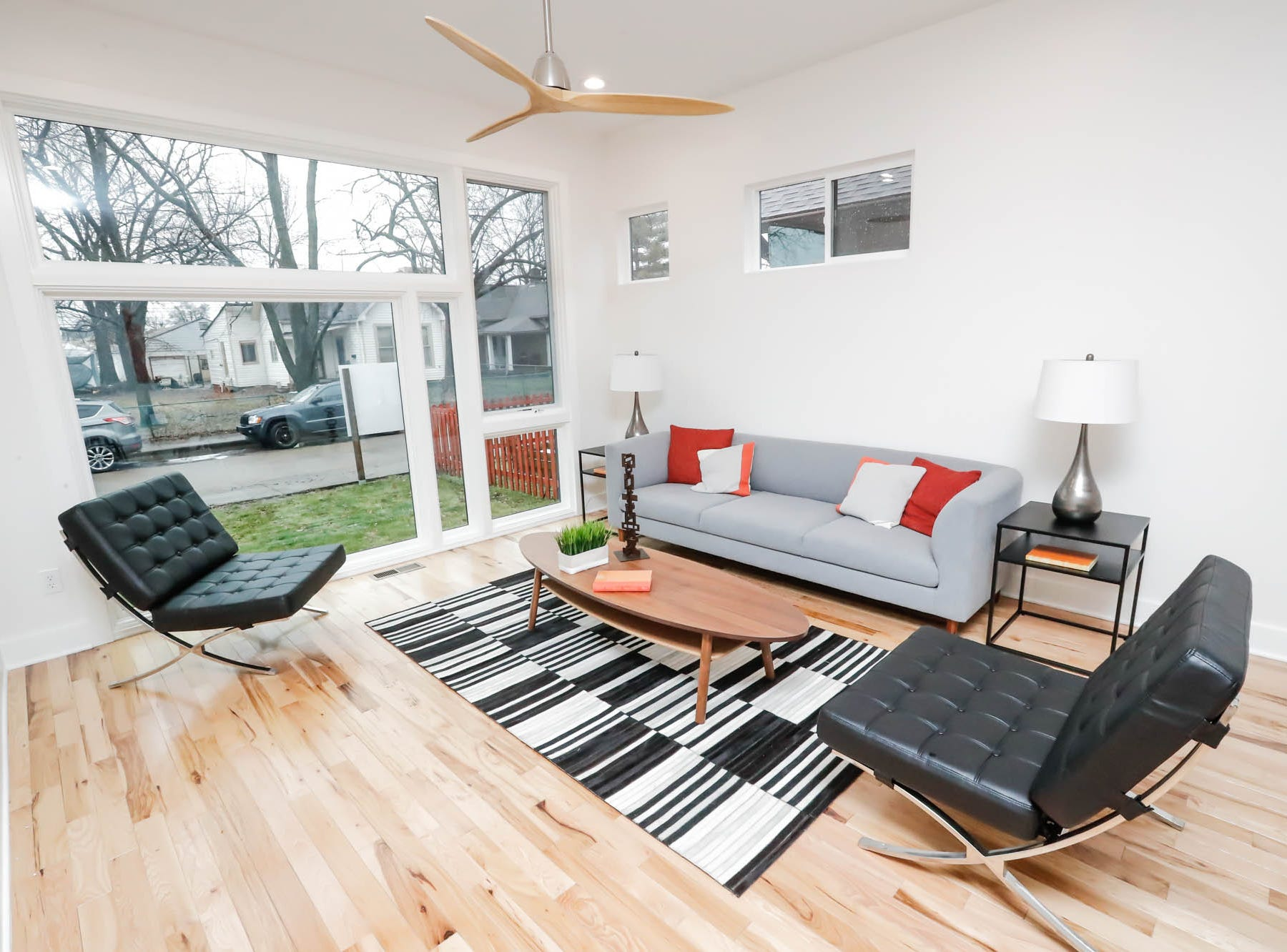 A newly built modern architectural home up for sale at 1134 Woodlawn Ave., Indianapolis, Ind., 46203, in the heart of the historic Fountain Square neighborhood, features large windows to allow in the maximum amount of light, on Wednesday, January 23, 2019. The three-story home, which features 2,030-square-feet and an open space concept tile and hardwood floors are priced at $479,900.