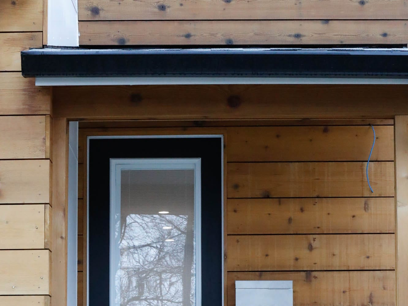 A modern front door allows the maximum amount of light in a newly built modern architectural home up for sale at 1134 Woodlawn Ave., Indianapolis, Ind., 46203, in the heart of the historic Fountain Square neighborhood on Wednesday, January 23, 2019. The three-story home, which features 2,030-square-feet and an open space concept tile and hardwood floors are priced at $479,900.