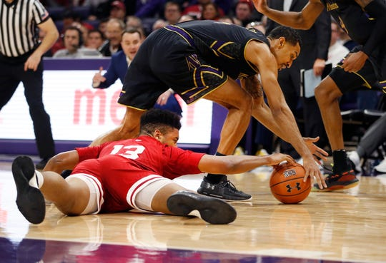 Hoosiers forward Juwan Morgan (13) and Northwestern Wildcats guard Ryan Taylor (14) going for a loose ball during the second half of the game at Welsh-Ryan Arena.