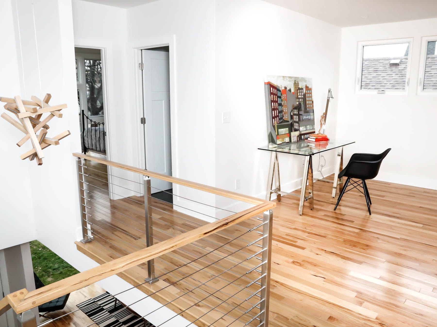 A second-floor landing features a space for a home office inside a newly built modern architectural home up for sale at 1134 Woodlawn Ave., Indianapolis, Ind., 46203, in the heart of the historic Fountain Square neighborhood on Wednesday, January 23, 2019. The three-story home, which features 2,030-square-feet and an open space concept tile and hardwood floors are priced at $479,900.