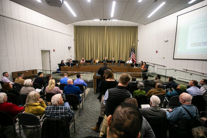 "Guillermo Treviño, a priest from St. Patrick Catholic Church in Iowa City, speaks during a public comment session of a City Council meeting on Tuesday, Jan. 22, 2019, in Iowa City, Iowa. Treviño spoke during a ""Prayer Vigil to Put The Poor First"" event in the lobby prior to the formal meeting after the council's discussion regarding pedestrian mall benches."