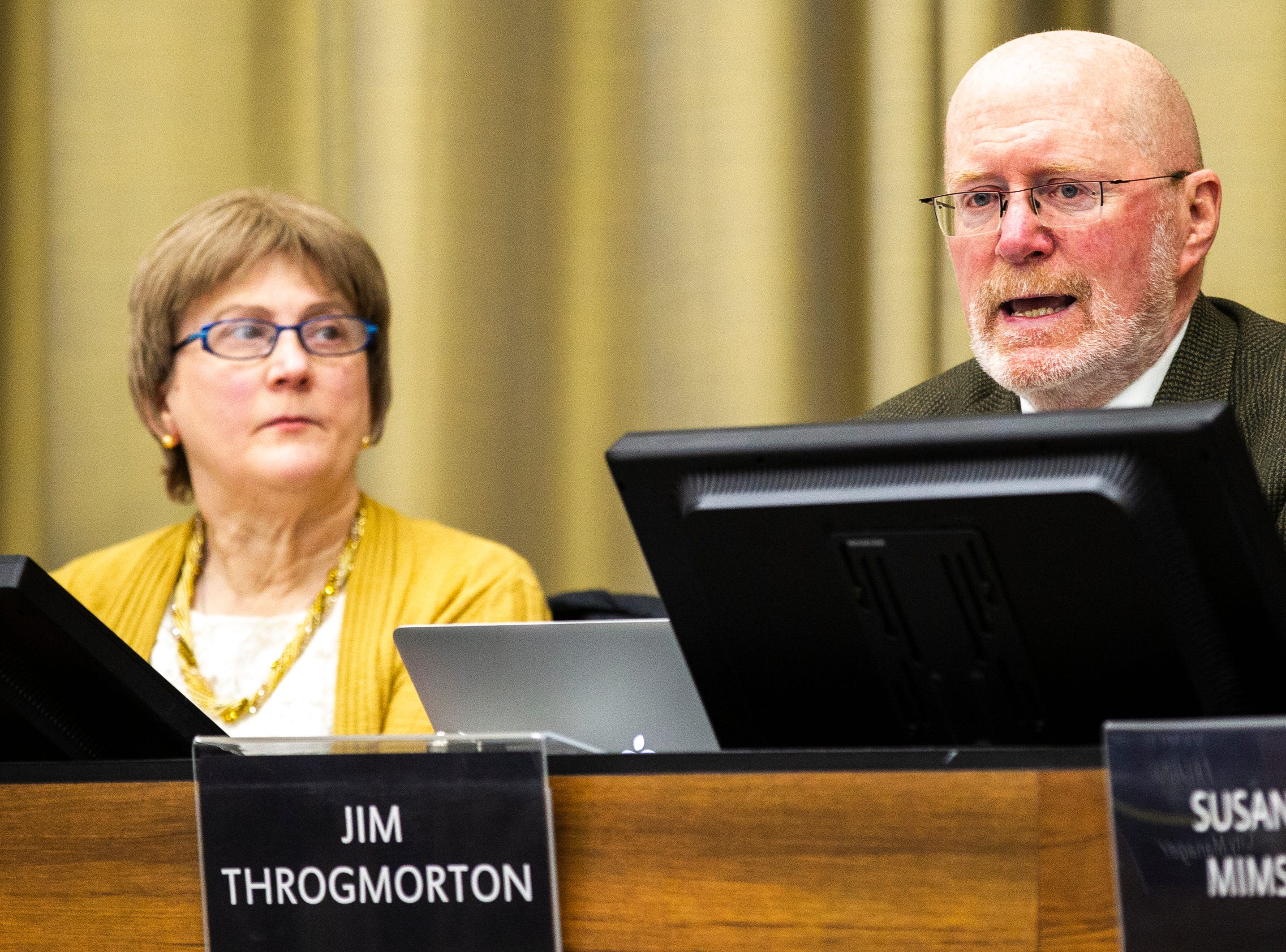 Iowa City Mayor Jim Throgmorton, right, speaks prior to public comment on Tuesday, Jan. 22, 2019, in Iowa City, Iowa.