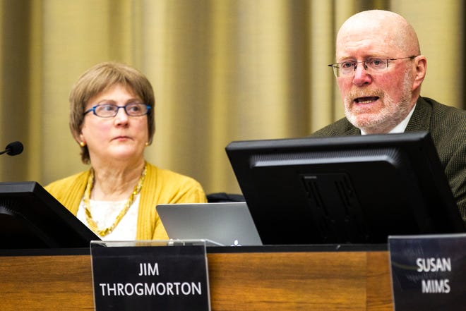Iowa City Mayor Jim Throgmorton, right, speaks prior to public comment on Tuesday, Jan. 22, 2019, in Iowa City, Iowa.