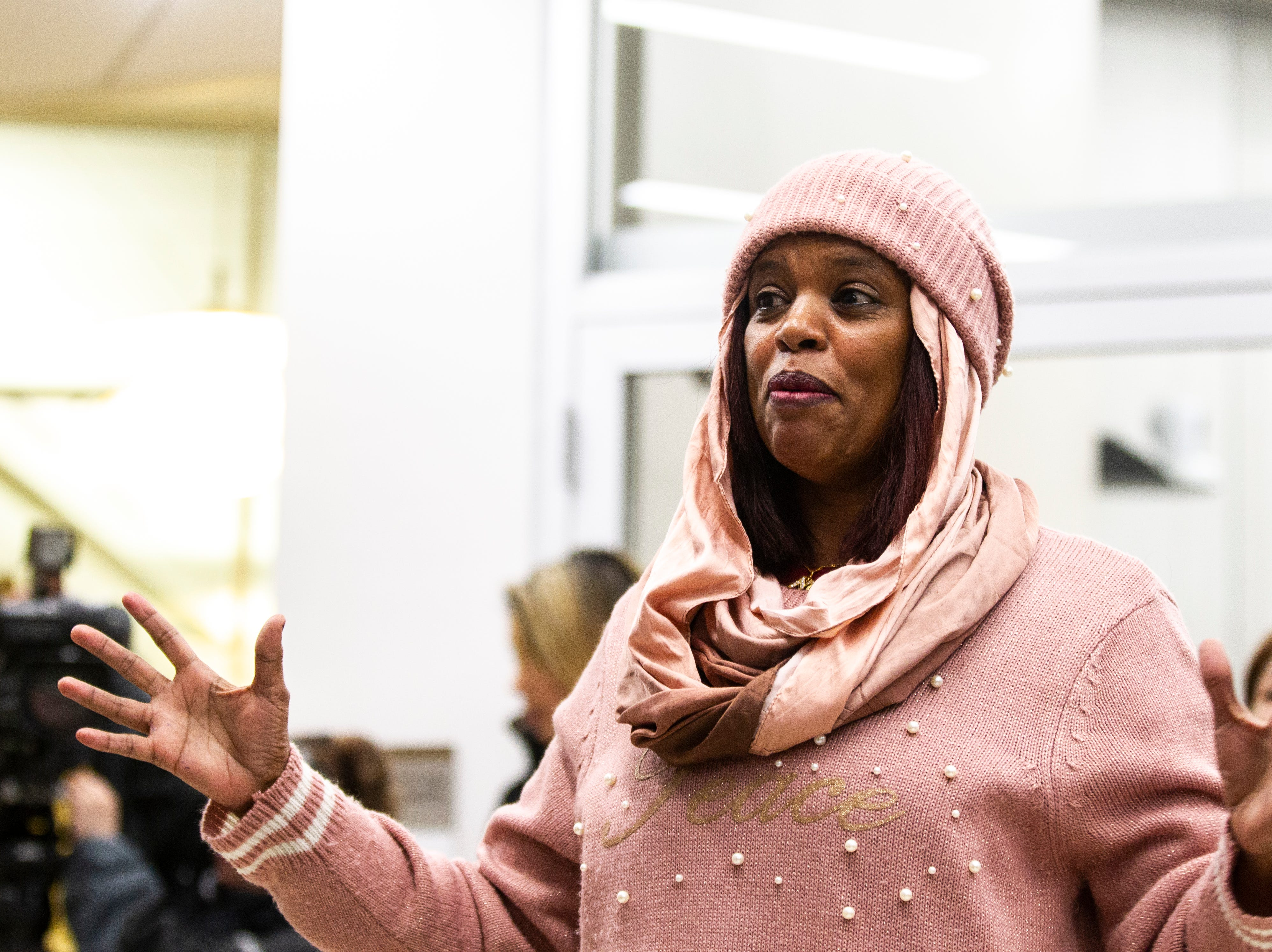 "City Councilor Mazahir Salih speaks to a group gathered during a ""Prayer Vigil to Put The Poor First"" after a council work session on Tuesday, Jan. 22, 2019, in Iowa City, Iowa."