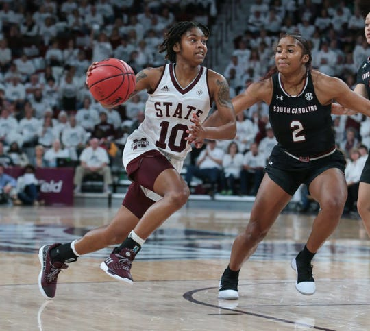 Mississippi State's Jazzmun Holmes (10) drives to the basket as South Carolina's Te'a Cooper (2) defends. Mississippi State played South Carolina in a women's SEC basketball game at Humphrey Coliseum on Thursday, January 17, 2019. Photo by Keith Warren