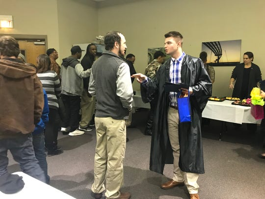 Graduate Jacob Morford speaks with a friend after the Jackson Day Reporting Center graduation ceremony on Jan. 23 in Jackson, Tenn.