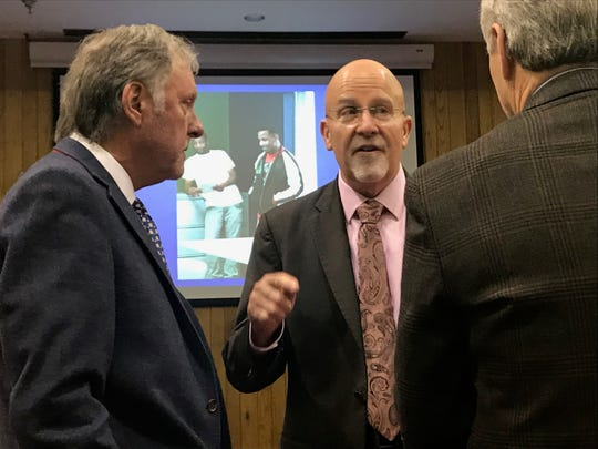 Edward Welch speaks with Madison County Mayor Jimmy Harris and Judge Donald Allen before the Jackson Day Reporting Center graduation ceremony on Jan. 23 in Jackson, Tenn.
