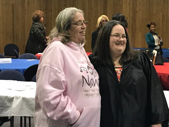 Graduate Bobbie Brooks hugs her mother, Judy Lutz, after receiving recognition at the Jackson Day Reporting Center graduation ceremony on Jan. 23 in Jackson, Tenn.