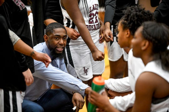 Aaron Woods has been Liberty's girls basketball coach for the past two seasons.