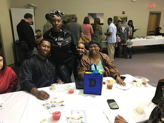 Graduate Jimmy Deberry poses with sister Kayla Deberry, cousin Daija Fizer and his mother Sharon Deberry at the Jackson Day Reporting Center graduation ceremony on Jan. 23 in Jackson, Tenn.