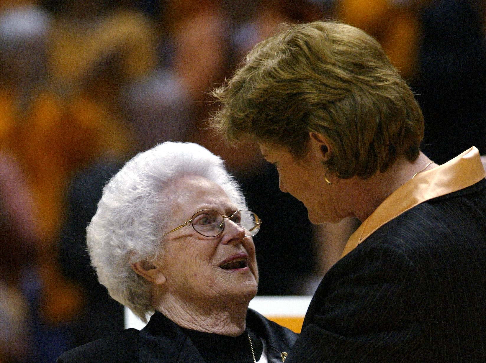 In this 2005 photo, Pat Summitt  hugs her mother during an award presentation after summitt won her  880 game.