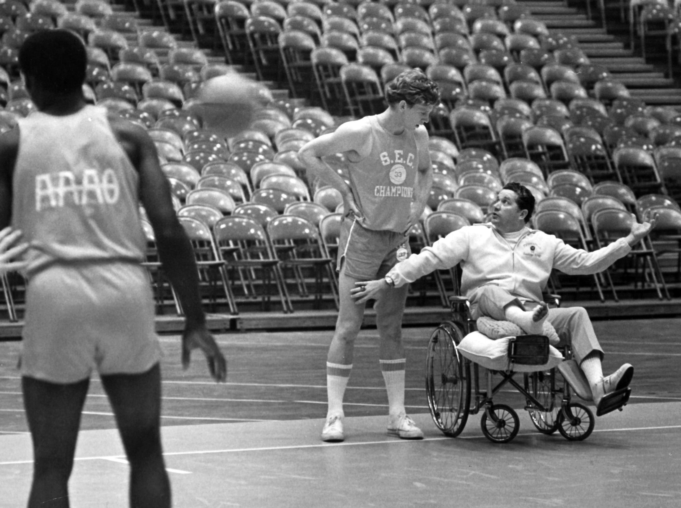 University of Tennessee basketball Coach Ray Mears, recovering from a ruptured Achilles tendon, conducts practice on Oct. 25, 1972, at Stokely Athletic Center. Mears died at age 80 on June 11, 2007.