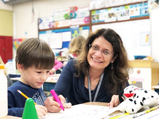Sterchi Elementary first-grade teacher Gretchen Edwards, with student Damien Smith. January 2019