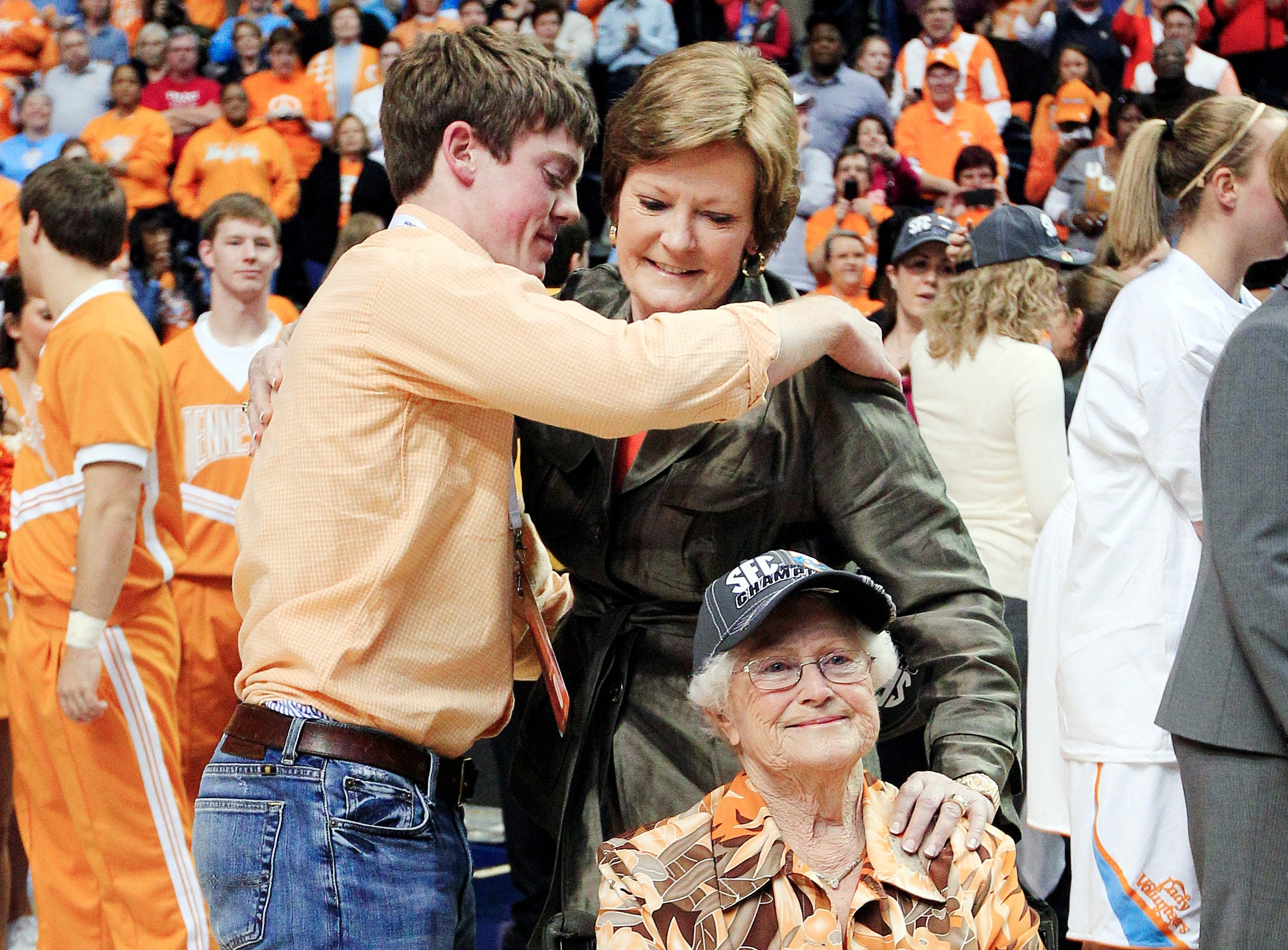 Pat Summitt embraces her son, Tyler, as she brings her mother, Hazel Head, onto the court after Tennessee defeated LSU 70-58 to win the the women's SEC championship on March 4, 2012, in Nashville.