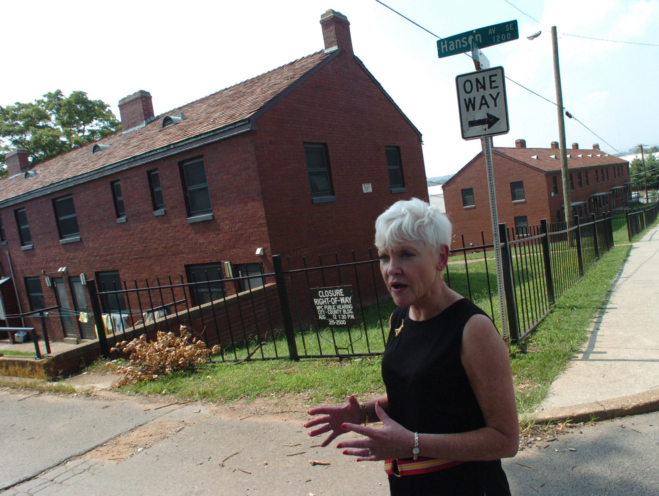 KCDC vice president for housing Billie Spicuzza talks about the planned demolition at Austin Homes Aug. 10, 2004.