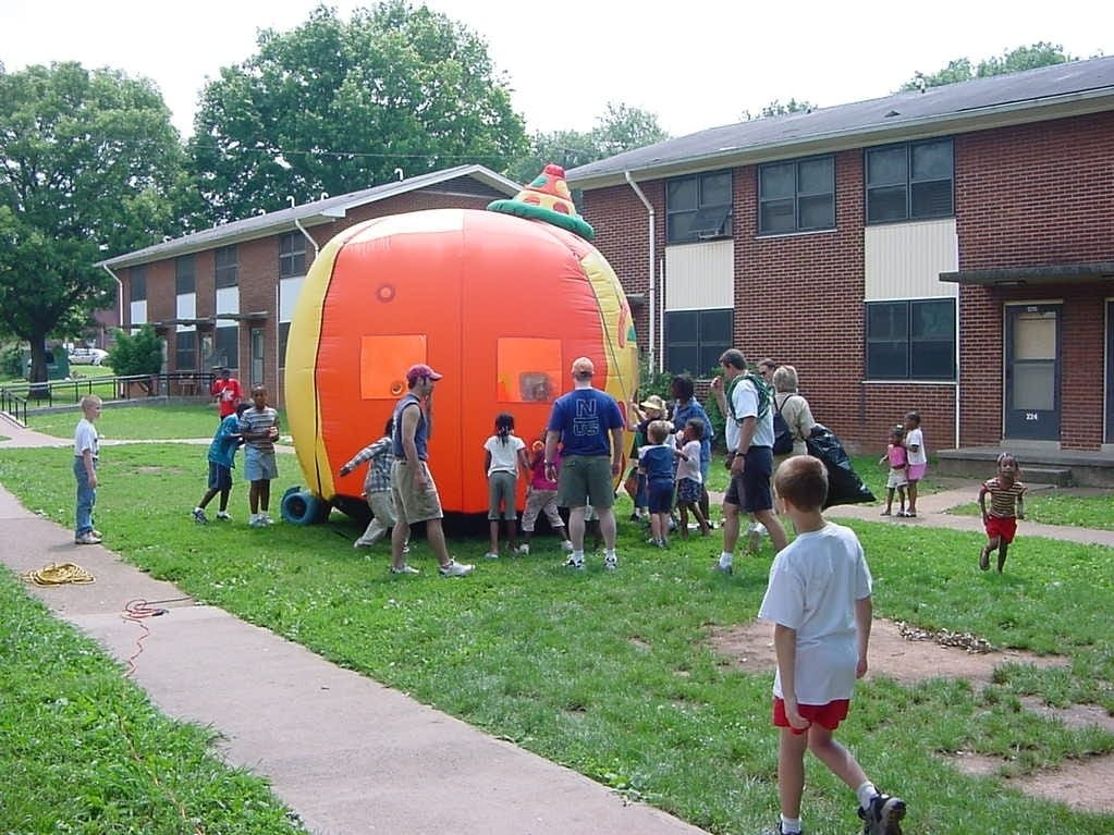 Volunteers from Bridgewater Baptist Church play with children outside The Lighthouse at Austin Homes housing project, part of the Hands and Feet Ministries outreach programs based at the West Knoxville church.