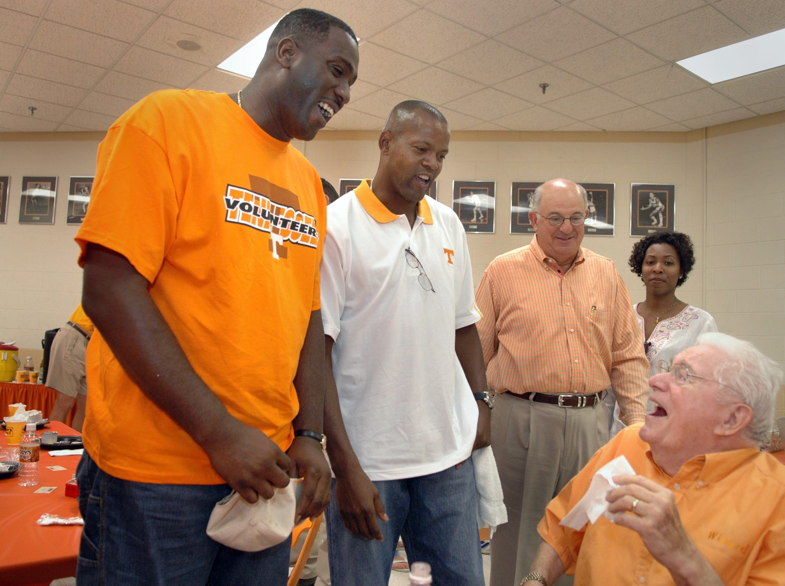Reggie Johnson, left, and Dale Ellis, center, talk with Ray Mears, seated,  Saturday at Thompson-Boling Arena.