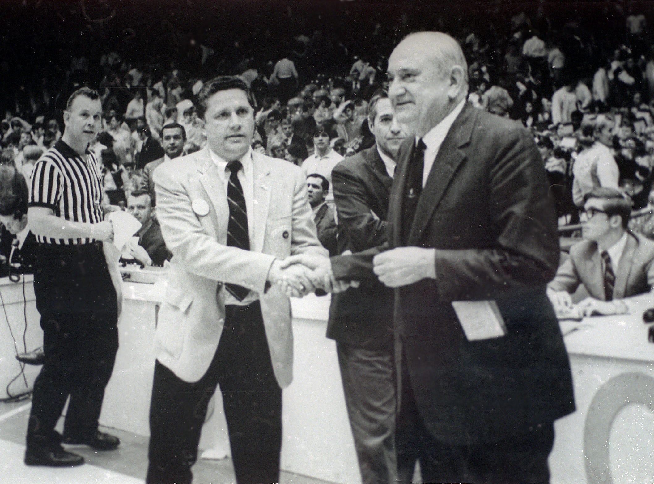 An undated photograph of University of Tennessee basketball Coach Ray Mears, left, with University of Kentucky Coach Adolph Rupp.