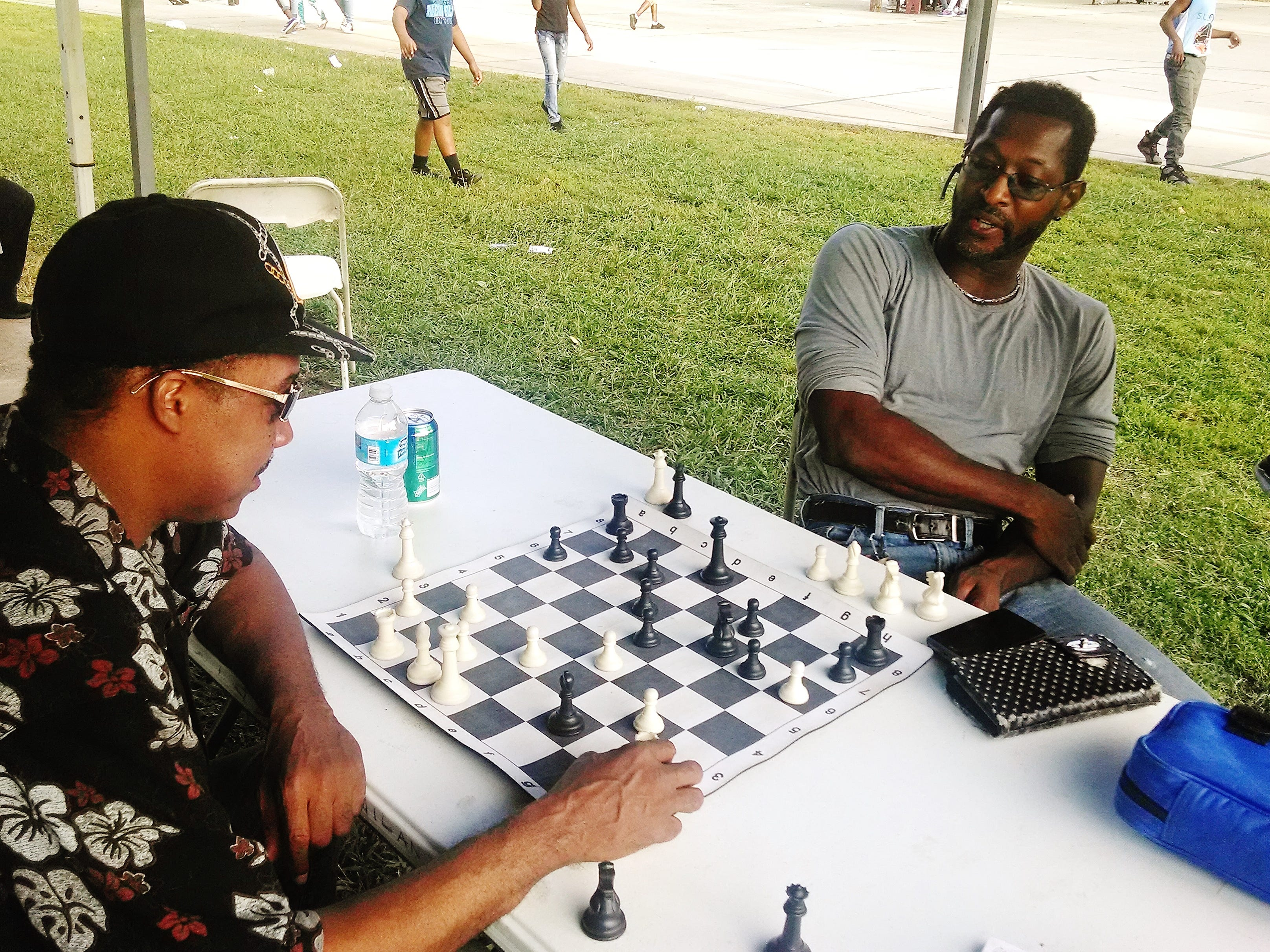 Arthur Asheford joined Carl Thomas in a game of chess during the Austin Homes reunion.