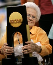 Tennessee coach Pat Summitt's mother, Hazel Head, takes charge of the national championship trophy after Tennessee beat Stanford 64-48 for its eighth women's basketball title, at the NCAA Final Four on Tuesday, April 8, 2008, in Tampa, Fla.