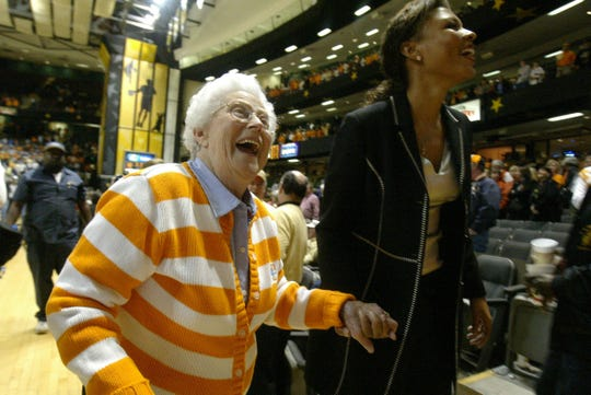 Lady Vol Coach Pat Summitt's mother, Hazel, is assisted by assistant coach Nikki Caldwell after the Vanderbilt game at Memorial Gymnasium in Nashville. Summitt notched career victory No. 900 with an 80-68 win