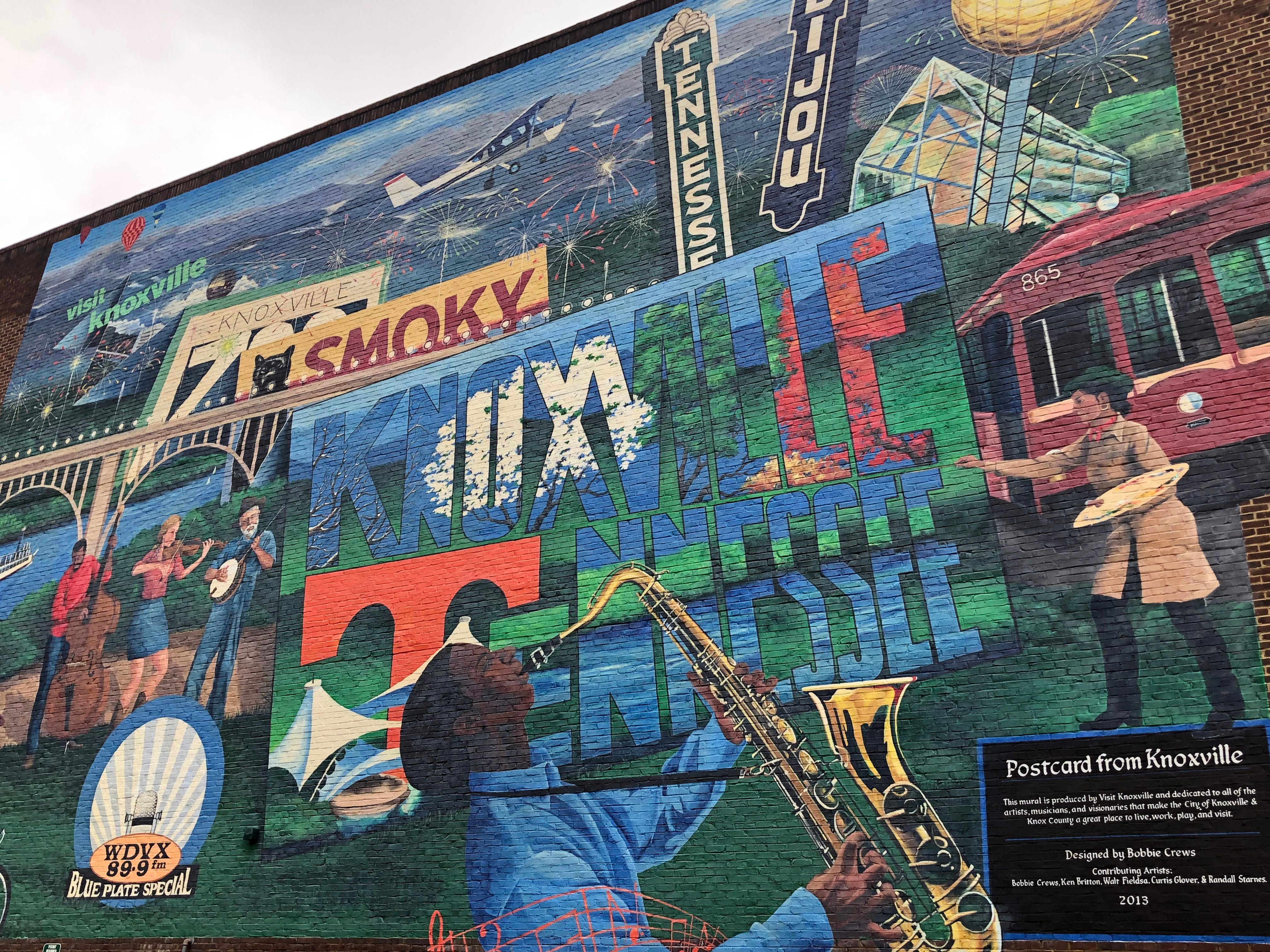 "This ""postcard from Knoxville"" is painted on the side of the Visit Knoxville building on Gay Street. It was designed by Bobby Crews and is dedicated to all of the artists, musicians and visionaries who make Knoxville a great place to live, work, play and visit."