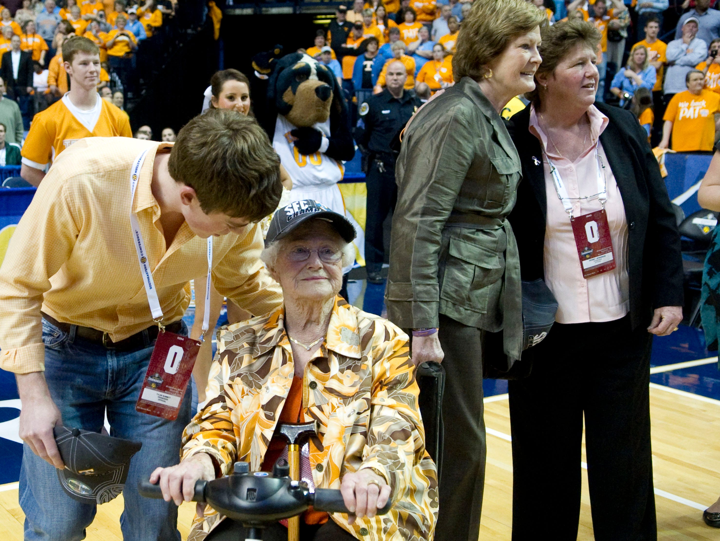 Tyler Summitt talks with his grandmother, Hazel Head, and Tennessee head coach Pat Summitt talks with Debbie Jennings, Associate Athletics Director for Media Relations during the celebration of Tennessee's win against LSU in the championship game of SEC Women's Basketball Tournament at Bridgestone Arena in Nashville, TN on Sunday, March 4, 2012.