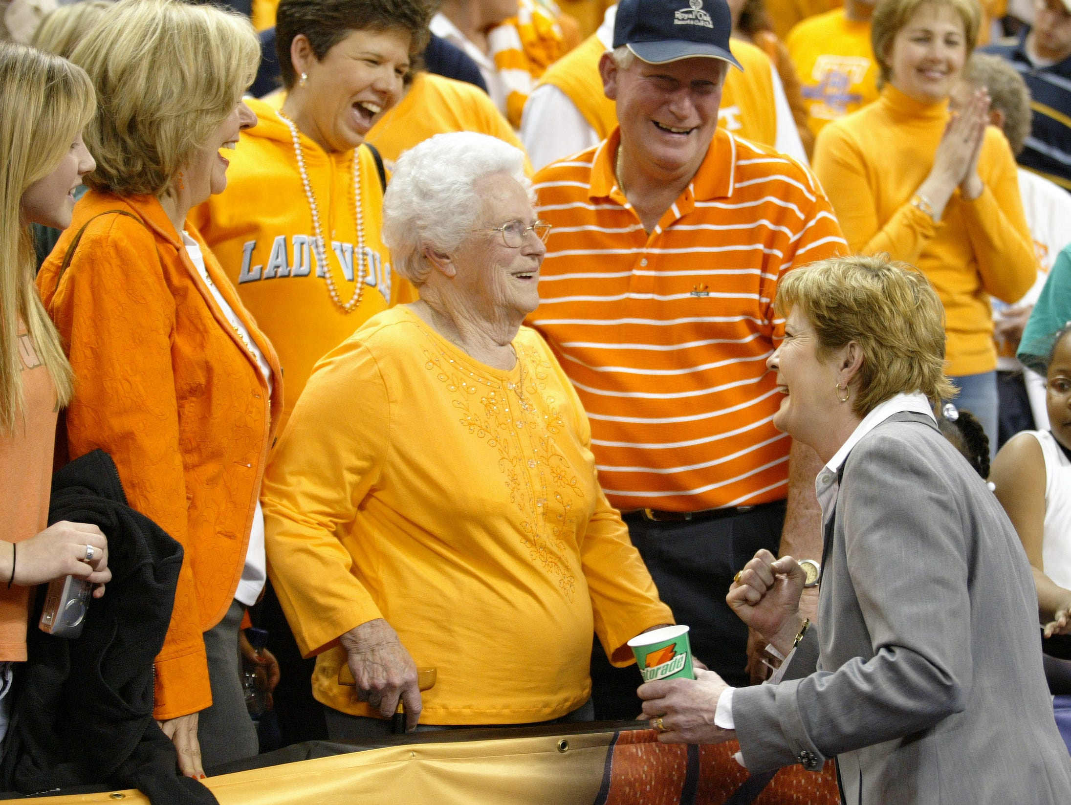 Pat Summitt celebrates with her mother, Hazel Head, after the Lady Vols defeated LSU in the SEC championship game on March 5, 2006 in Little Rock, Ark. Also pictured are her brother Kenneth Head and a friend, Margaret Carter, left, wearing orange jacket.