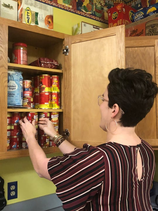 Kirby Deal, a staff member at Girls Inc. of the Tennessee Valley, sorts nonperishable food donated to support families during the government shutdown.