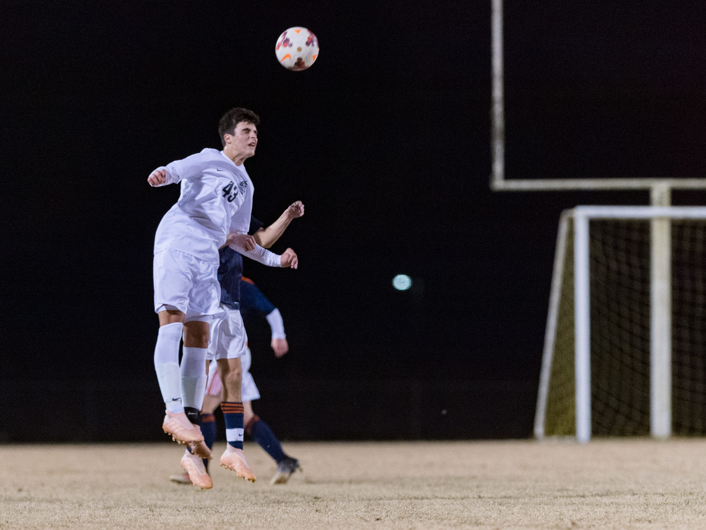 Townes Wallace header as Beau Chene takes on STM in Boys soccer. Tuesday, Jan. 22, 2019.