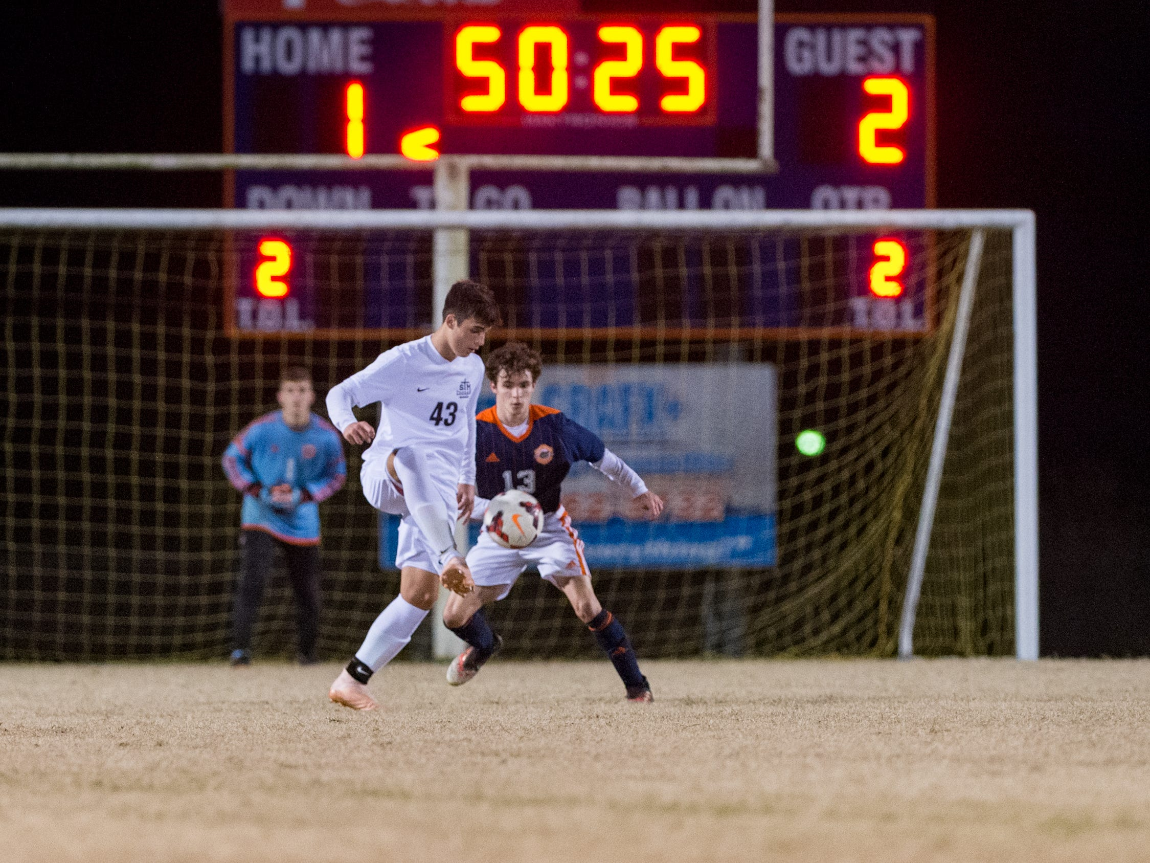Townes Wallace moves the ball defended by Bryson Noel as Beau Chene takes on STM in Boys soccer. Tuesday, Jan. 22, 2019.
