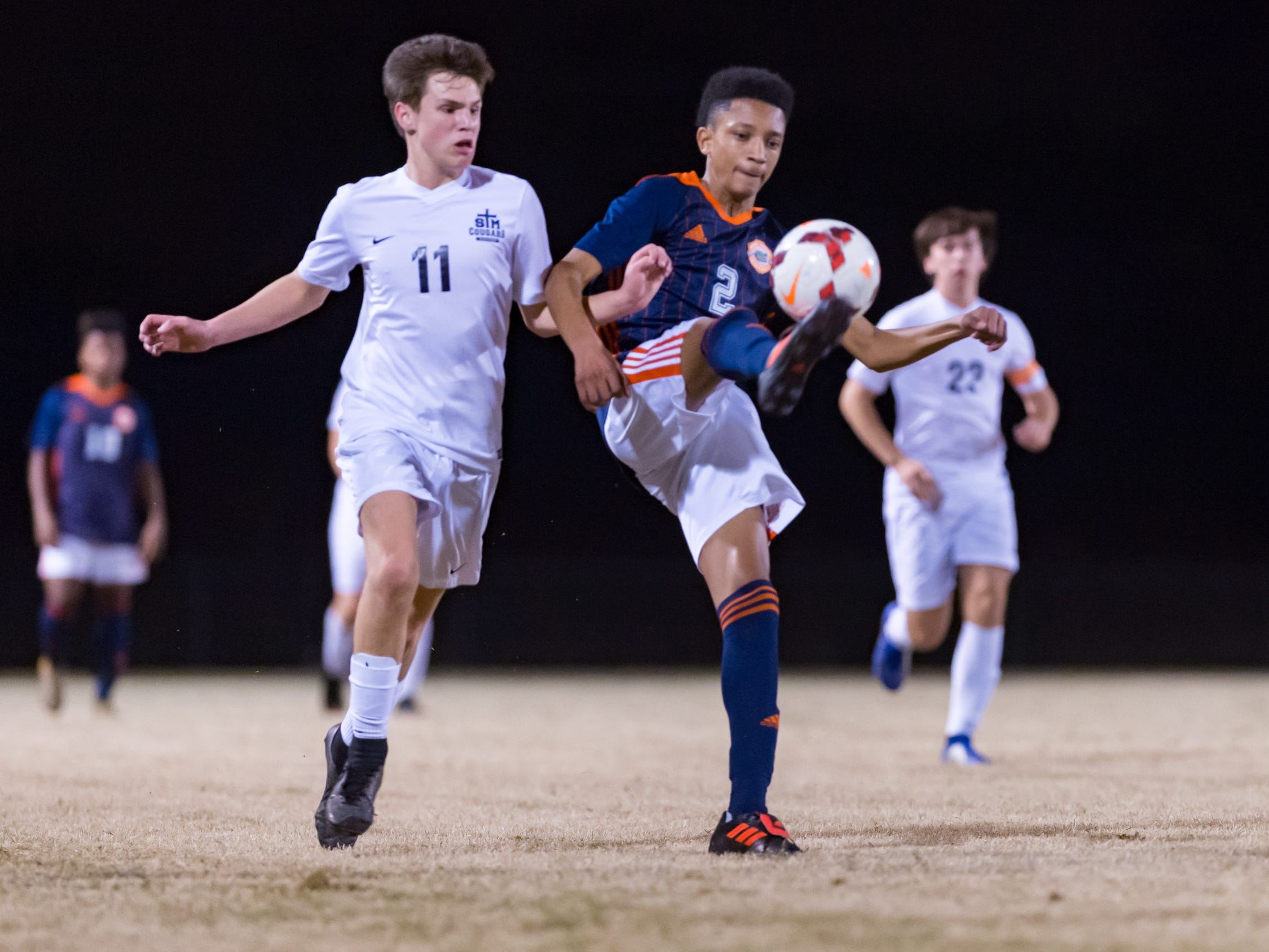 Devin Auzenne and Ethan Mowell battle for the ball as Beau Chene takes on STM in Boys soccer. Tuesday, Jan. 22, 2019.