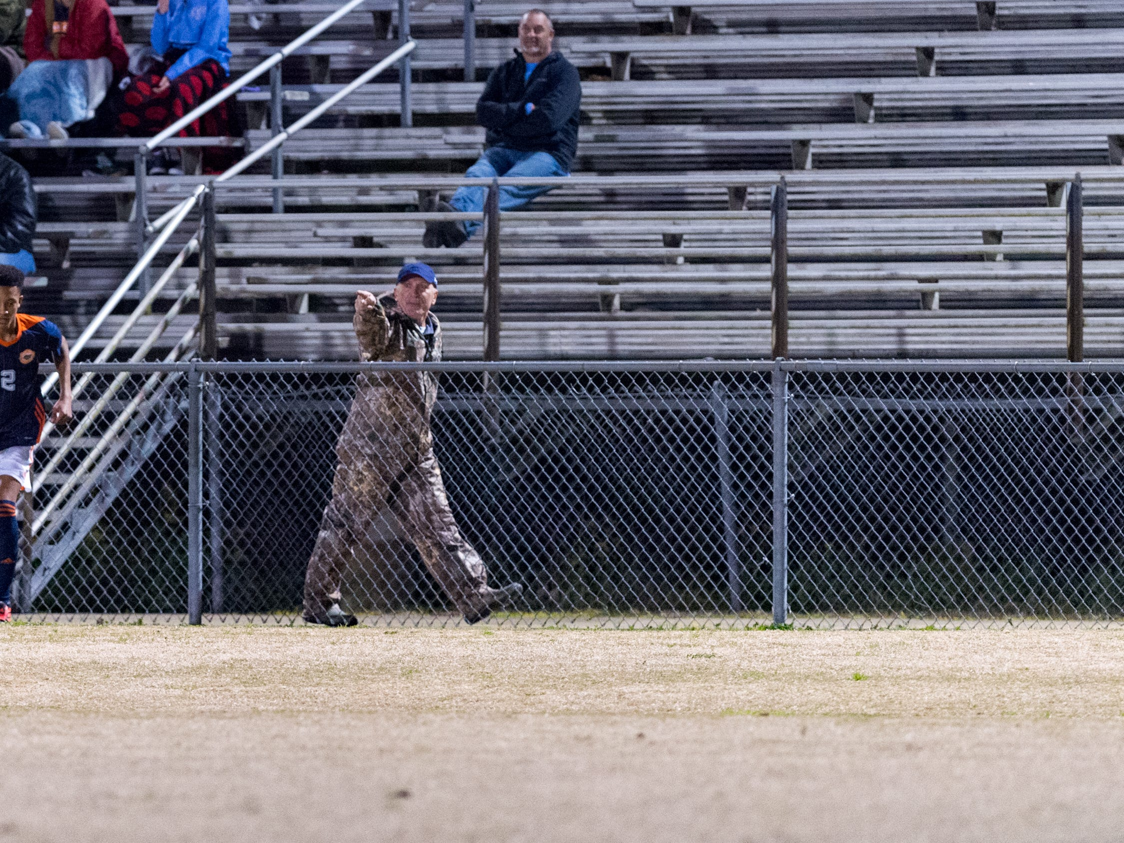 Game officials eject fan from the game as Beau Chene takes on STM in Boys soccer. Tuesday, Jan. 22, 2019.