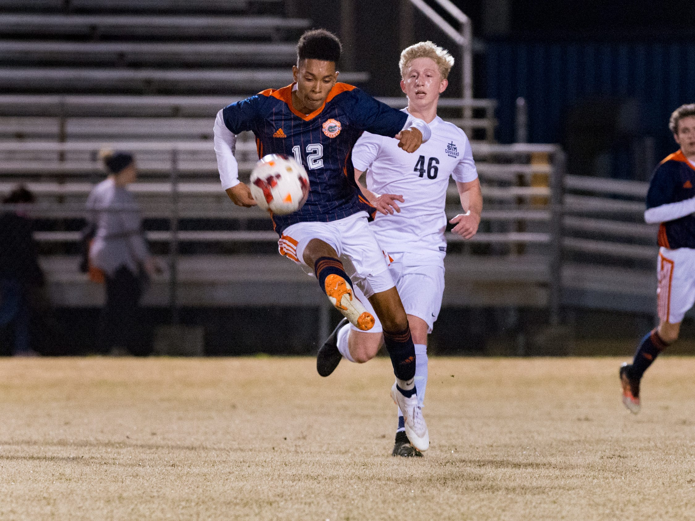 Alex Auzenne moves the ball as Beau Chene takes on STM in Boys soccer. Tuesday, Jan. 22, 2019.
