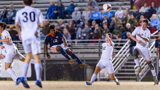 Adrian Eaglin takes a shot as Beau Chene takes on STM in Boys soccer. Tuesday, Jan. 22, 2019.