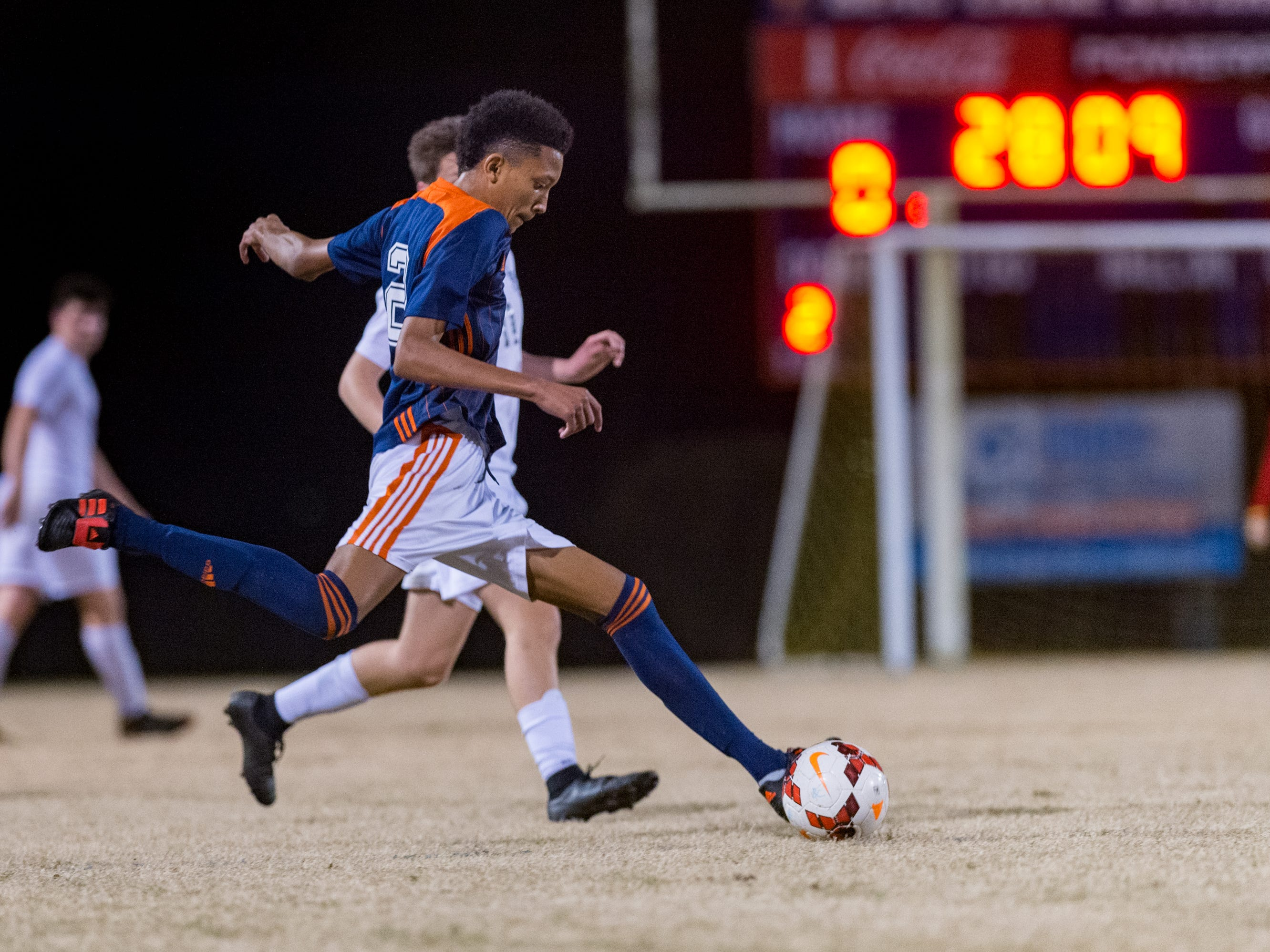 Devin Auzenne moves the bal as Beau Chene takes on STM in Boys soccer. Tuesday, Jan. 22, 2019.