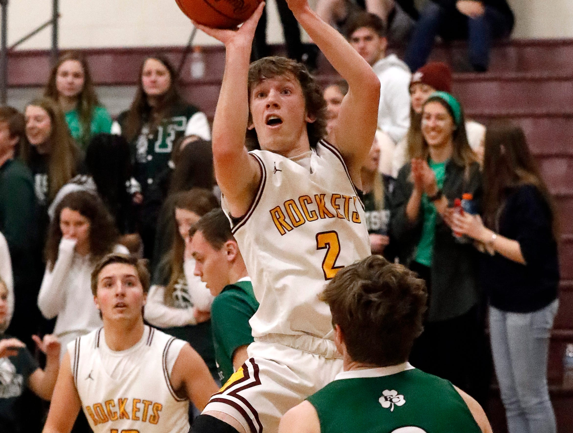 Berne Union's Chase McCartney takes a shot during Tuesday night's game, Jan. 22, 2019, against Fisher Catholic at Berne Union High School in Sugar Grove. The Rockets defeated the Irish 58-49.