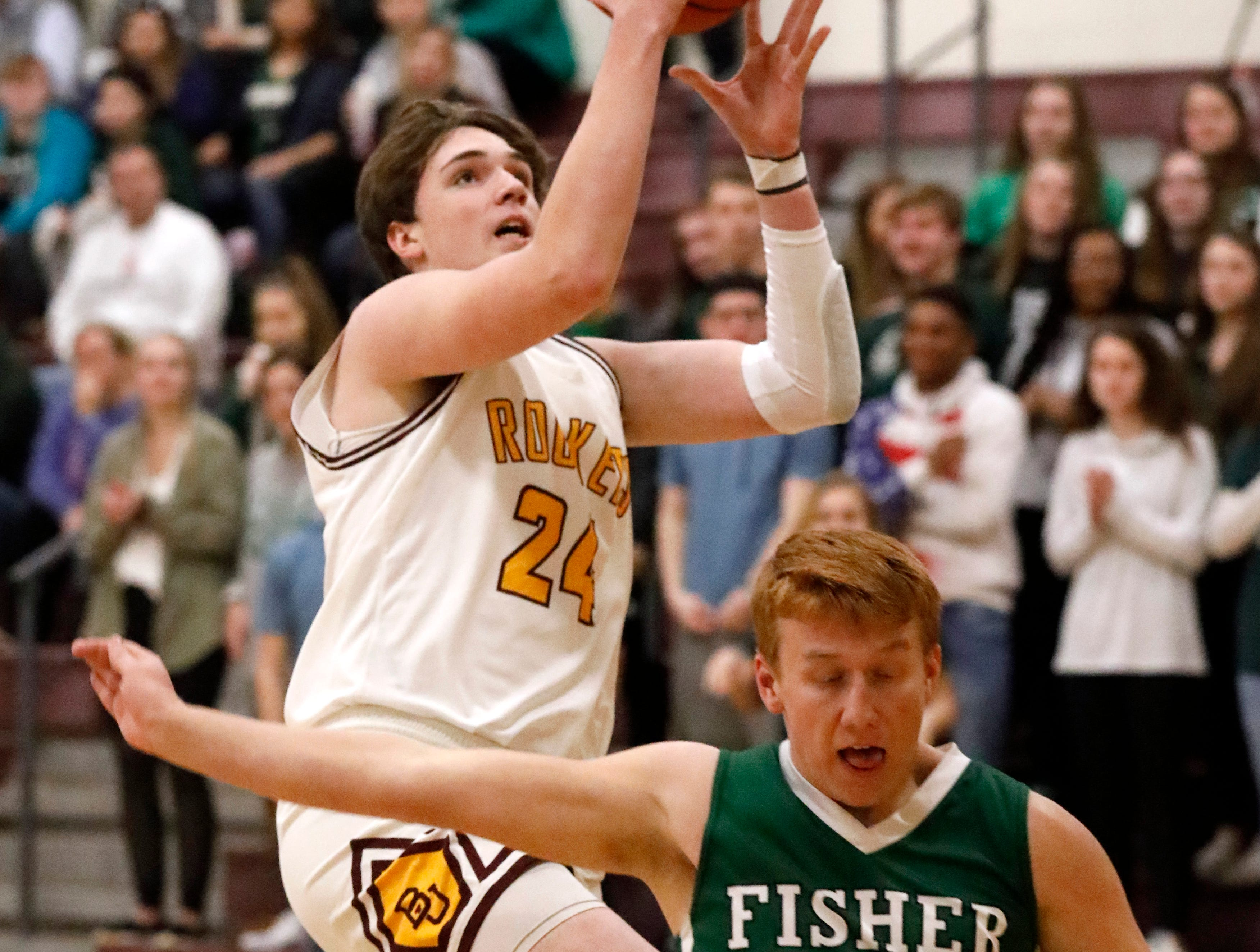 Berne Union's Brock Unger goes up for a shot during Tuesday night's game, Jan. 22, 2019, against Fisher Catholic's Carter Brady at Berne Union High School in Sugar Grove. The Rockets defeated the Irish 58-49.