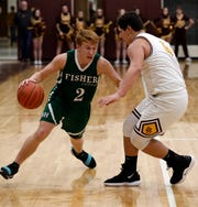 Fisher Catholic senior guard Carter Brady dribbled past a defender during game earlier this season. For the second straight year, the Irish earned the top seed in Division IV.