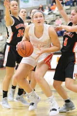 Brighton's Sophie Dziekan, who had 22 points and 12 rebounds, moves between Northville's Nicole Martin (24) and Lauren Marshall (0) in a 53-23 victory on Tuesday, Jan. 22, 2019.