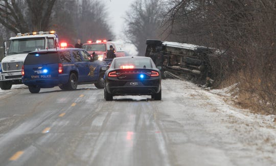 Icy roads caused several crashes Wednesday, Jan. 23, 2019, including this roll-over crash on Nicholson Road north of Sargent Road in Handy Township.