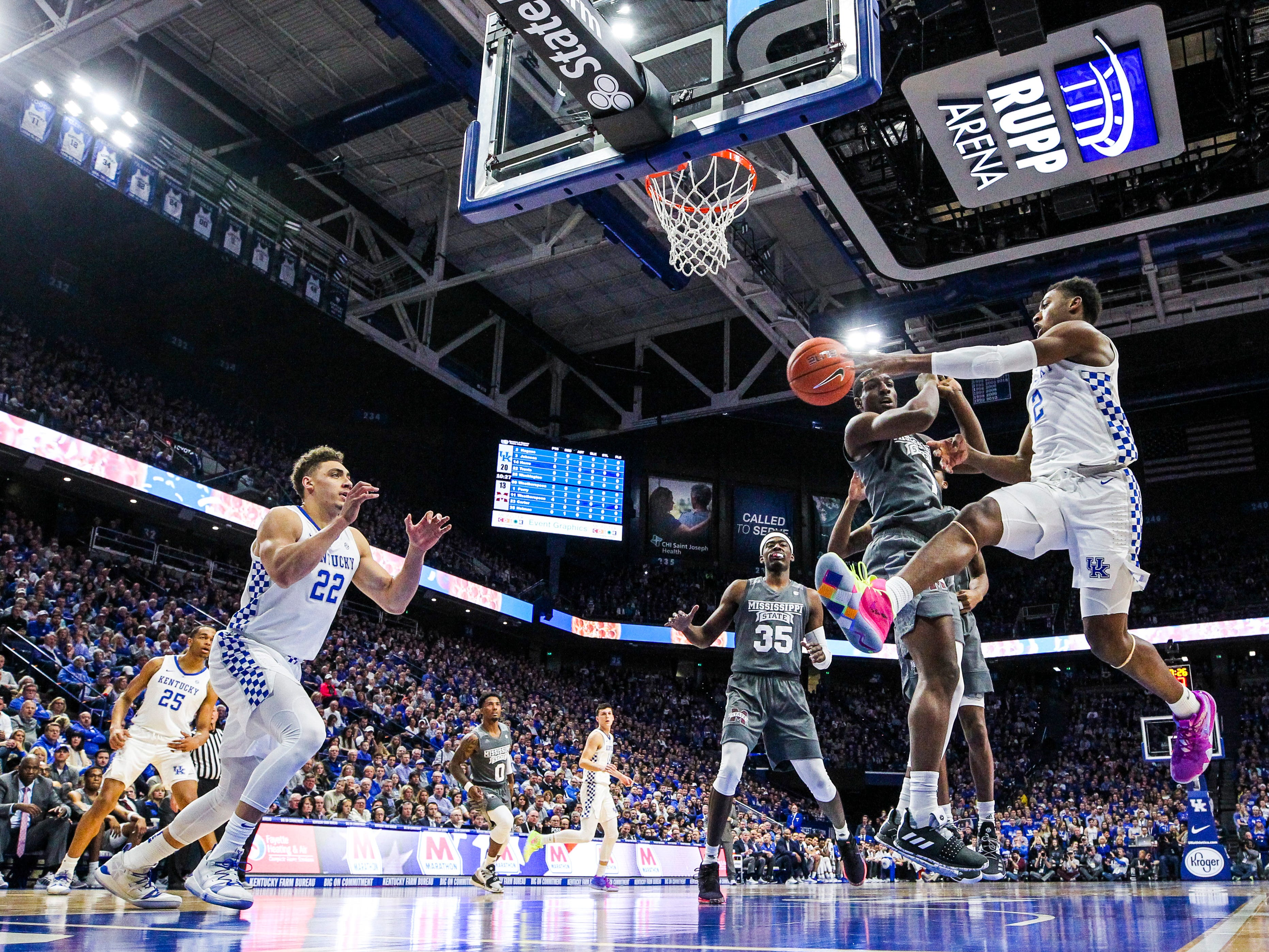 Kentucky's Ashton Hagans passes to Reid Travis around a Mississippi State defender  Tuesday night at Rupp Arena in Lexington. The Wildcats won 76-55, their first consecutive wins over ranked teams since 2011. January 22, 2019