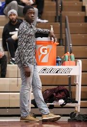 Sam Ajagbe on the sideline of a Ballard basketball game in January.