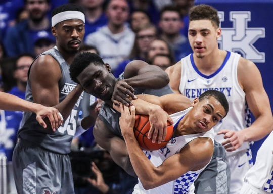 Kentucky's Keldon Johnson wrestled for the ball with Mississippi State's Abdul Ado Tuesday night at Rupp Arena in Lexington. January 22, 2019