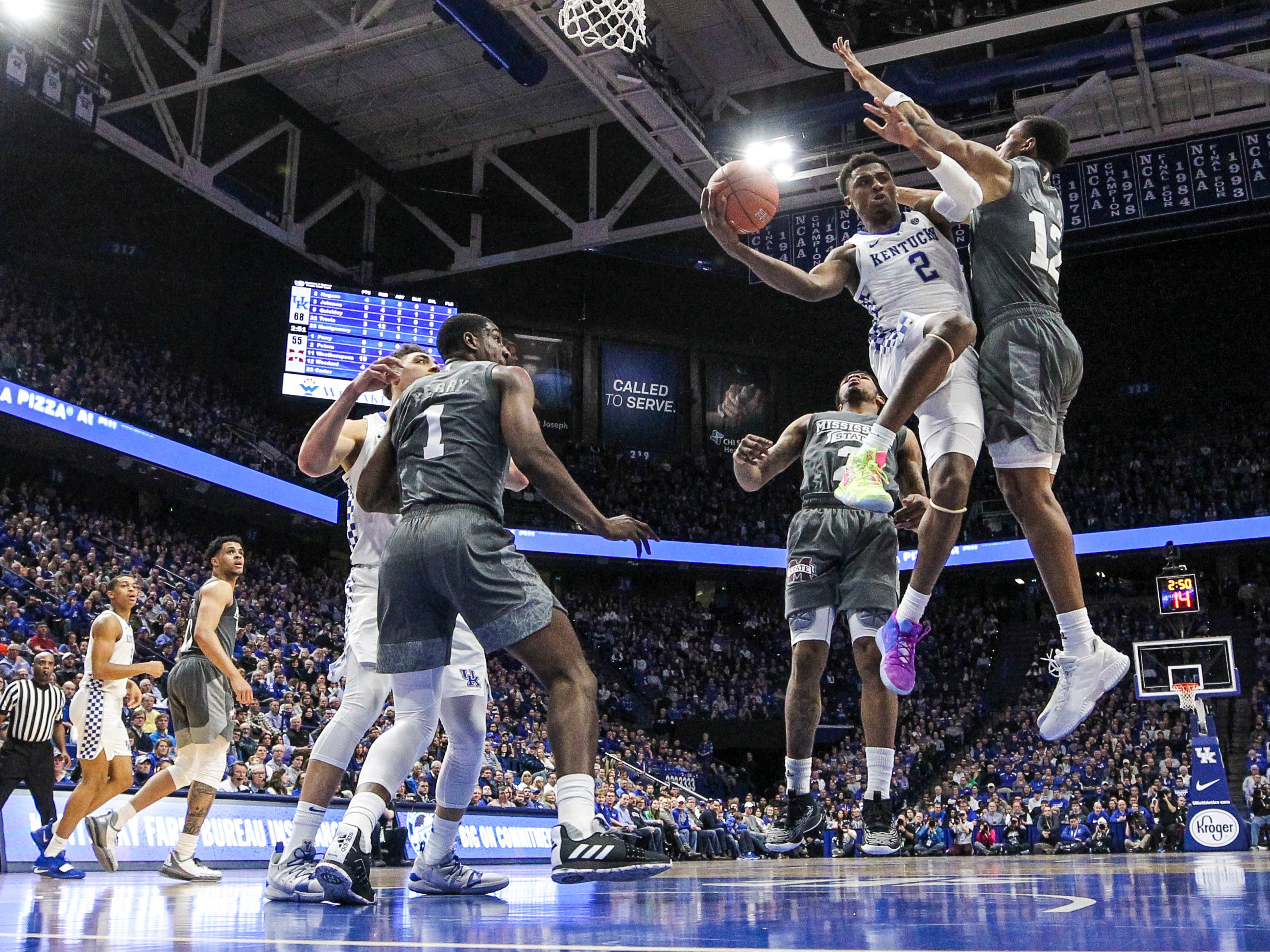 Kentucky's Ashton Hagans passes around  Mississippi State Tuesday night at Rupp Arena in Lexington. Hagans had five points but nine assists and two steals as the Wildcats won 76-55.