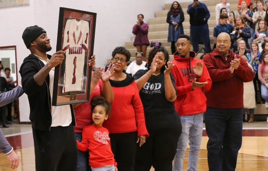 Former Ballard standout football player DeVante Parker, left, hoisted his jersey which was retired during BallardÕs basketball game against J-Town at Ballard High School.  He was accompanied by his family.  Parker was a star wide receiver at U of L and currently plays for the Miami Dolphins.