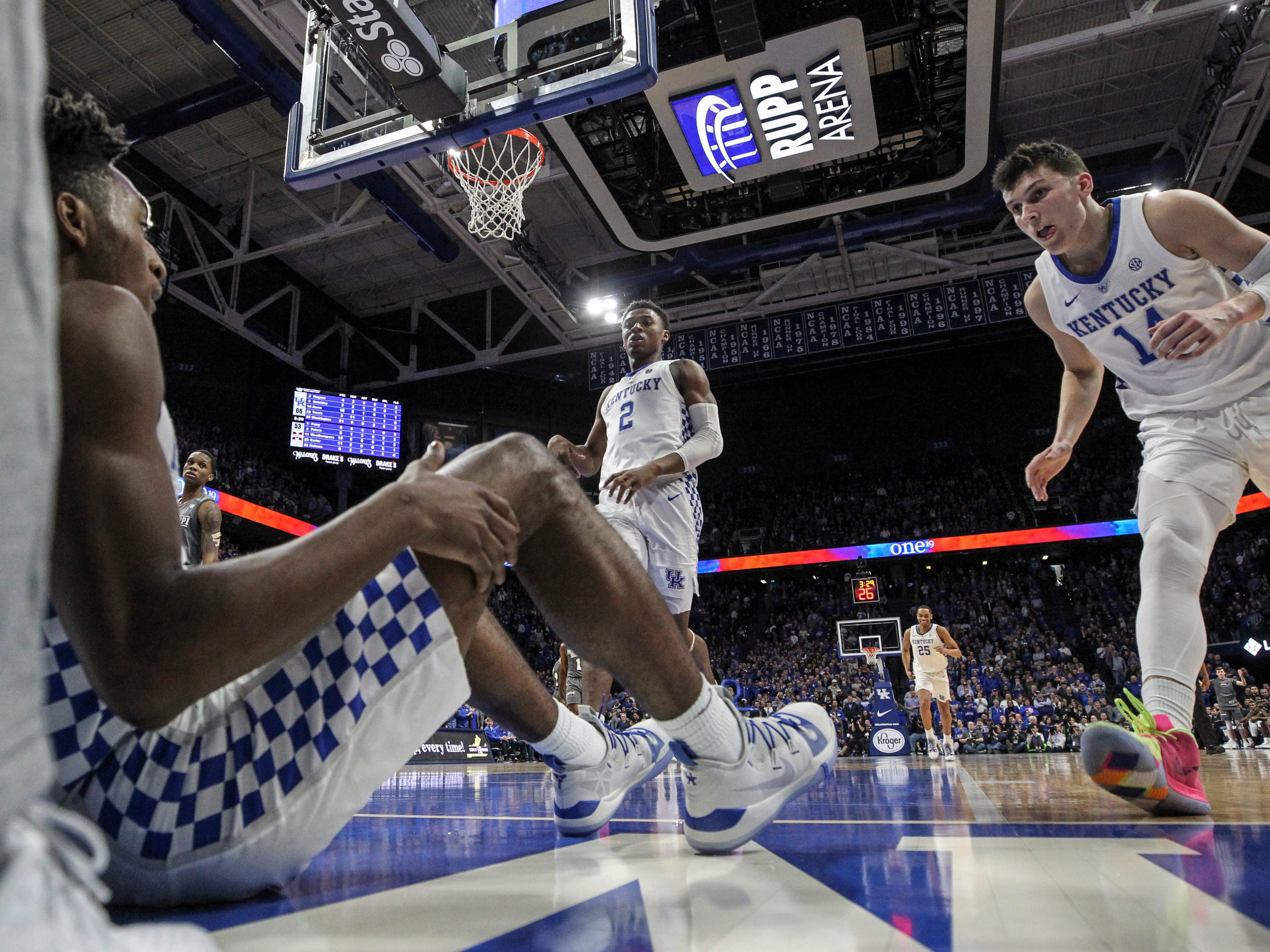 Kentucky's Immanuel Quickley was knocked down by Mississippi State while driving to the basket as teammate Tyler Herro ran to help him up Tuesday night at Rupp Arena in Lexington.