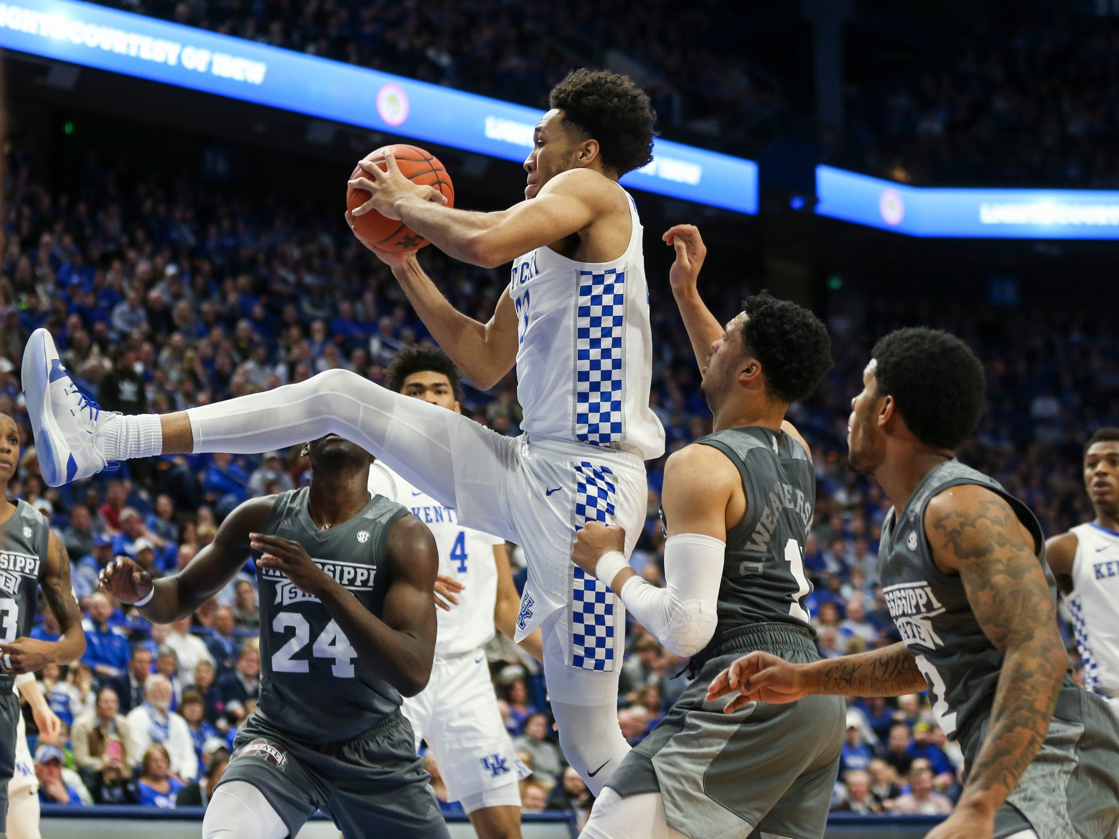 Kentucky's EJ Montgomery grabs a rebound during the Wildcats' 76-55 win Tuesday night at Rupp Arena in Lexington. He finished with five points, including a three-point shot which garnered praise from coach John Calipari.