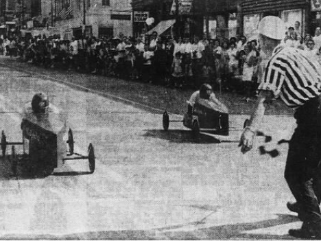 Allan Smith, a 13-year-old from Westphalia, gets the final flag to win the 1964 Clinton County Soap Box Derby