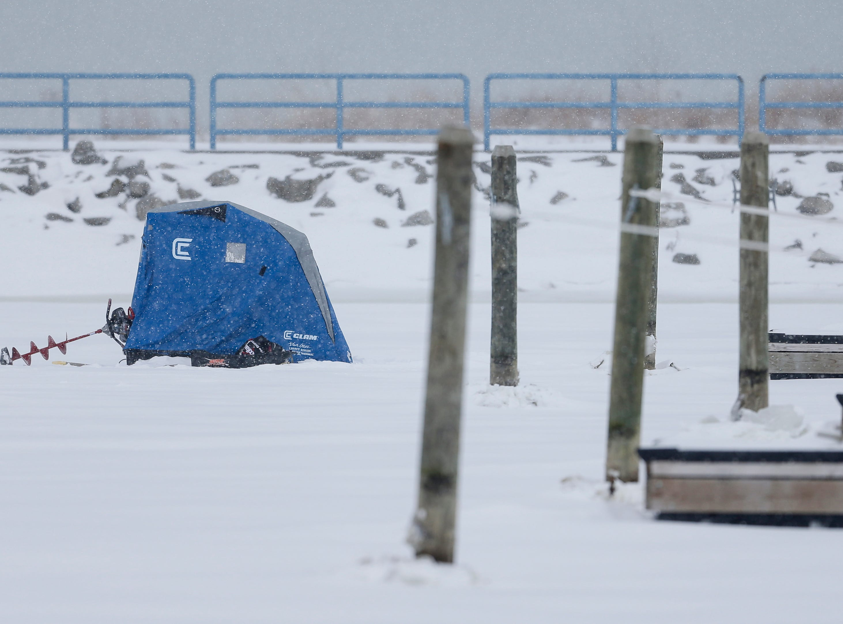 An ice fishing shelter sits on the Manitowoc harbor during a snowstorm Wednesday, January 23, 2019, in Manitowoc, Wis. Joshua Clark/USA TODAY NETWORK-Wisconsin